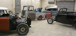 classic cars under construction at dmc